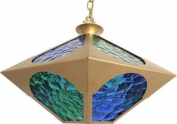 """Light-filled modern pendant light featuring alternating blue and green stained glass panels in a hexagonal brass frame with scalloped cutouts. Fully restored with new wiring and new porcelain socket for one standard  150W-maxbulb. Comes ready to install with a 36""""L adjustable chain and ceiling canopy. Heavy, high quality piece for any space where you want to add color and light."""