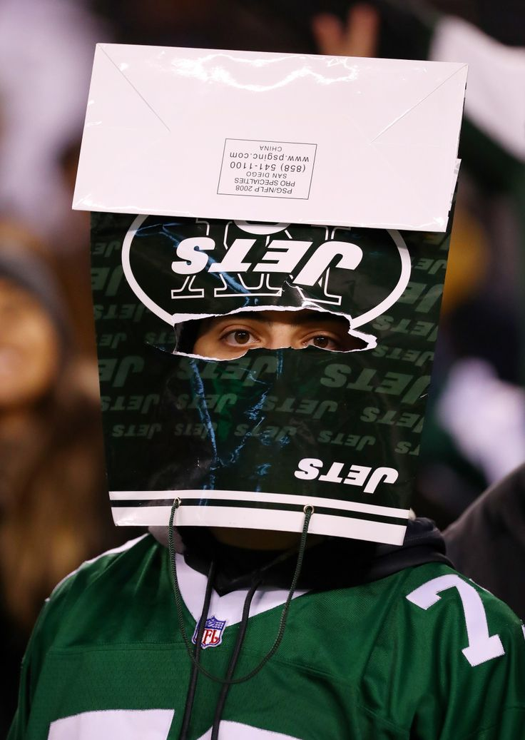 EAST RUTHERFORD, NJ - DECEMBER 05: A New York Jets fan wears a bag on his head after they were defeated by the Indianapolis Colts 41 to 10 at MetLife Stadium on December 5, 2016 in East Rutherford, New Jersey. (Photo by Al Bello/Getty Images) ORG XMIT: 681233843 ORIG FILE ID: 627925910