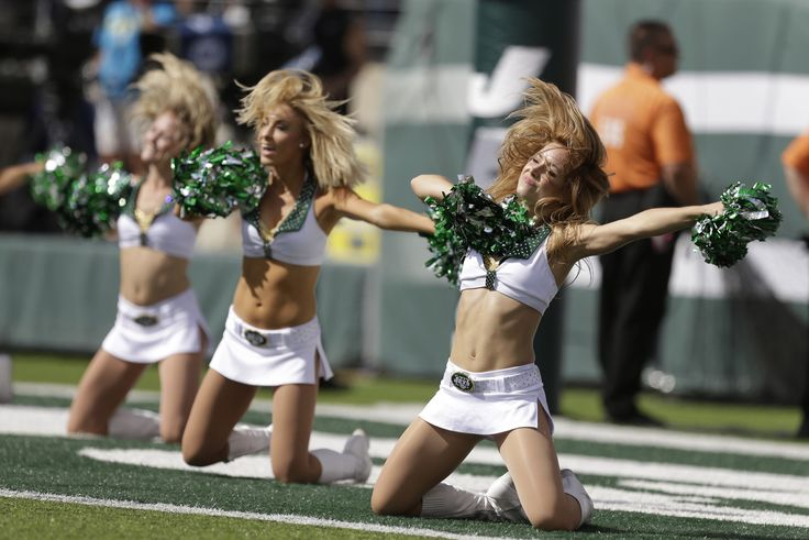 New York Jets cheerleaders perform during the first half of an NFL football game against the Detroit Lions, Sunday, Sept. 28, 2014, in East Rutherford, N.J. (AP Photo/Frank Franklin II)