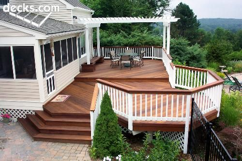 love the arbor over part of the deck. love the stairs. (needs benches instead of railing or in addition)