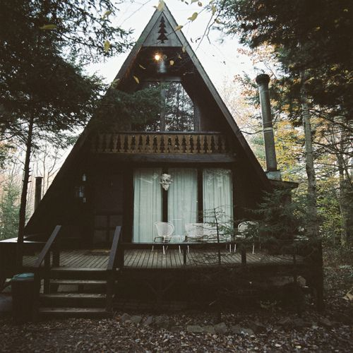 A-Frame cottage with smokestack chimney