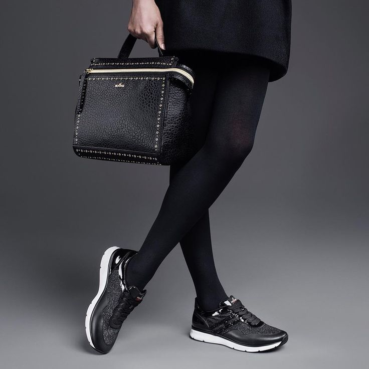 An exquisite match. The #HOGAN #FW1617 #Traditional 20.15 #sneakers paired with #HOGAN mini hand bag in chrome-dyed leather  Join the #HoganClub #lifestyle and share with us your @hoganbrand pictures on Instagram