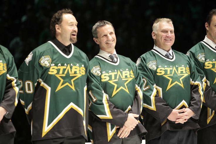MARCH 8: Former Dallas Stars Ed Belfour, Guy Carbonneau and Brett Hull were present to see their teammate, Mike Modano's #9 be retired prior...