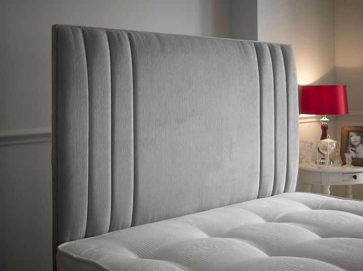 The Zien headboard is a modern stylish headboard which makes any normal divan bed look a lot better.  It features a decorative vertical inset grooves at the outer edge. It is available in all sizes, fabrics and leathers. http://www.chicconcept.co.uk/5247-zien--5055157.html