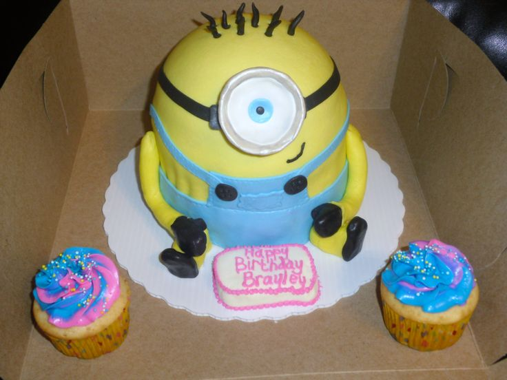 Despicable Me Minion  - Despicable Me Minion cake covered in marshmallow fondant ... I covered the bottom of foam cup with fondant and sprinkled with silver dust for the eye piece .  I used two tiers of 6 inch cake and 1 half 3d cake pan for head .