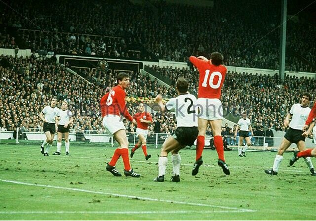 England 4 West Germany 2 in 1966 at Wembley. Geoff Hurst jumps up for a header in the World Cup Final.