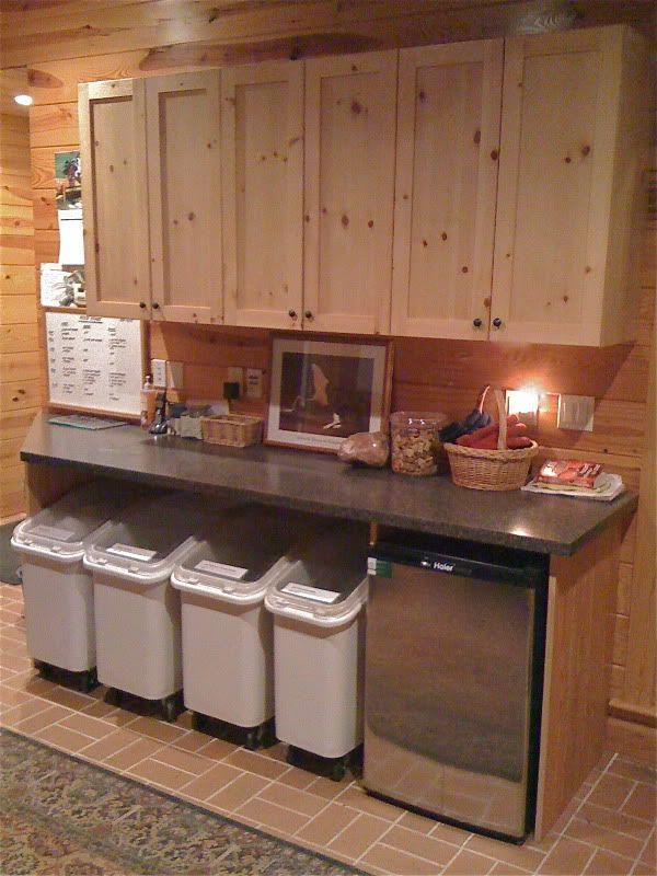 Sweet idea for kennel. Storage with a small fridge for dog foods. Love the wood choice for overhead cabinets.