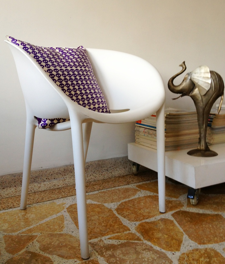 Withe chair & purple skulls