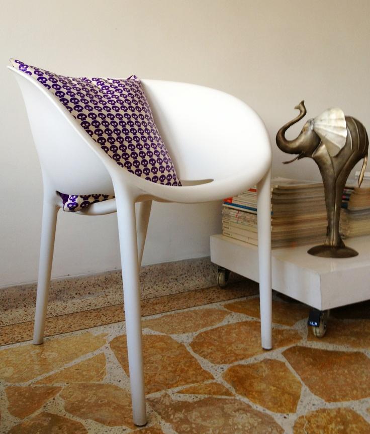 Withe chair & purple skulls