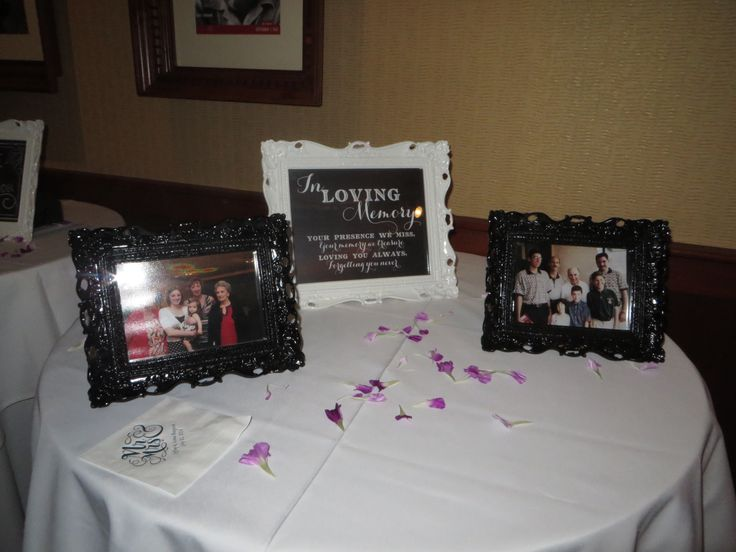 aimee and jeff remembered those who passed with a memory table at their wedding reception in