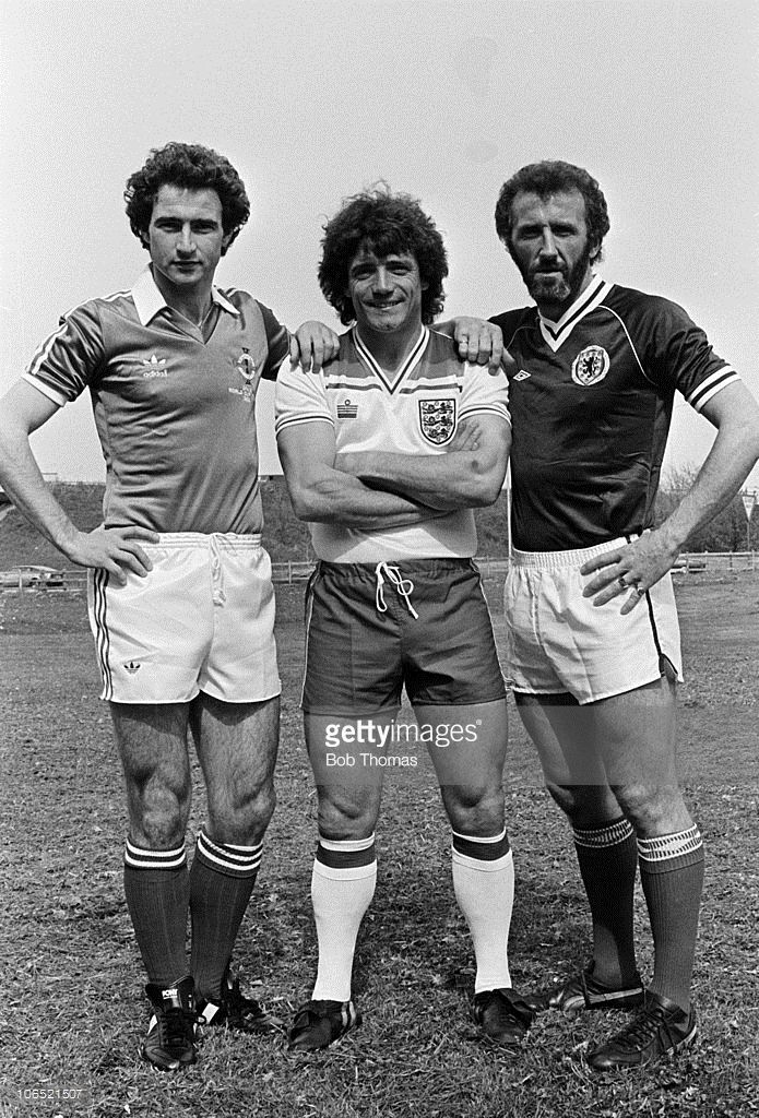 The captains of England, Northern Ireland and Scotland - Kevin Keegan, Martin O'Neill (left) and Danny McGrain (right) - pose for a unique photograph at Heathrow Airport before travelling to the World Cup Finals in Spain on 25th April 1982.