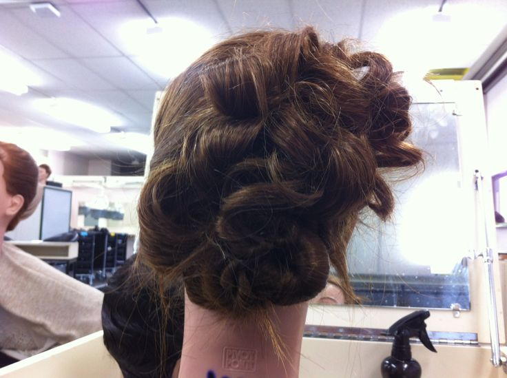 complex hair up.... petals, twist , knots more of a smooth finish
