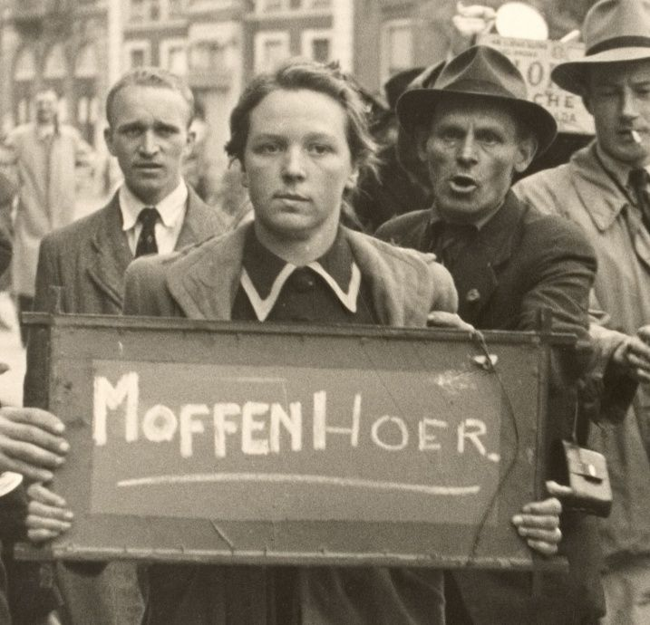 Moffenhoer (=Kraut whore) After the liberation on May 5th 1945 Dutch women who had an amorous relationship with German soldiers were badly treated. Their hair was shaved off, they were publicly shamed, beaten, often smeared with paint.