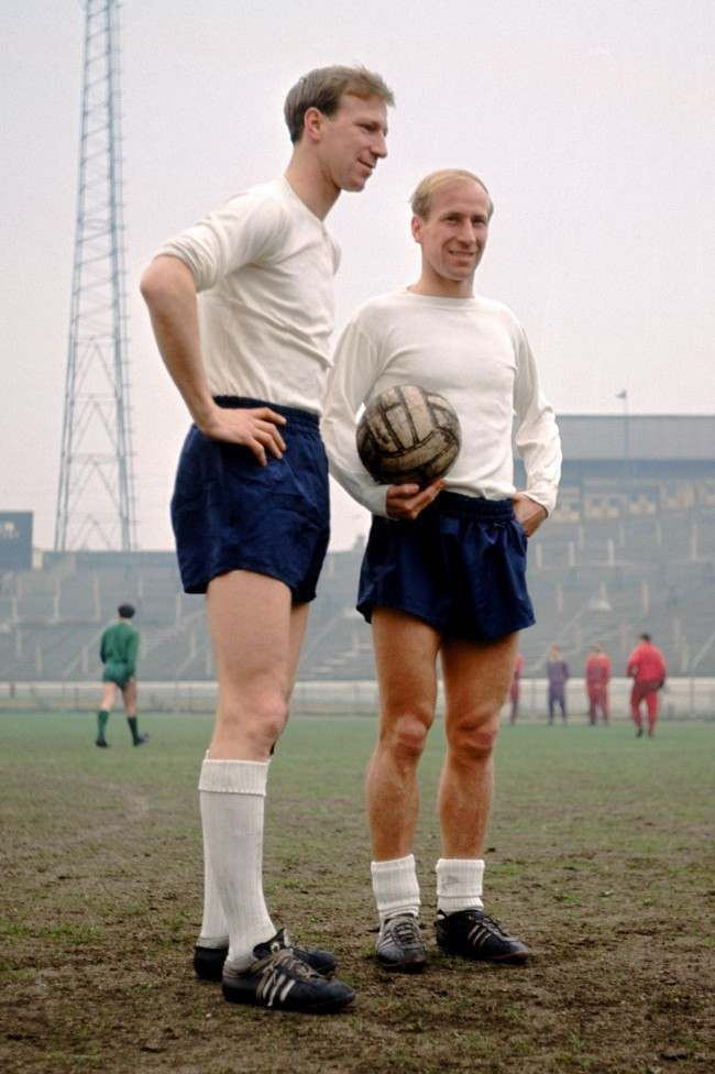 Jack (left) and Bobby Charlton (right), England, take a break in training at…