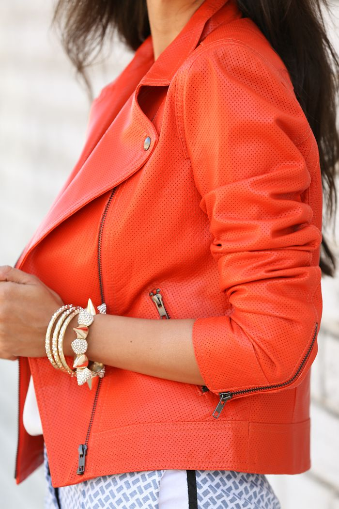 orange leather cropped jacket with zippers.