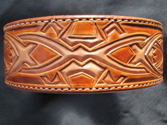 Handmade leather dog collar in large, Celtic style design tooled. This large collar is comprised of fresh 13 oz. saddle skirting with a premium