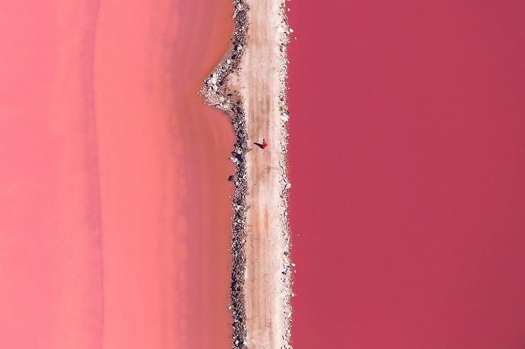 Lake Hillier, Australia -  It's not an optical illusion; the unique lake is a bright bubblegum pink, thanks to pigmented algae. Situated on Middle Island, off the southern coast of Western Australia, the stunning pink lake is best seen from the sky. Oh, and pack your bikini—the rose-tinted water is safe to swim in, and thanks to its high