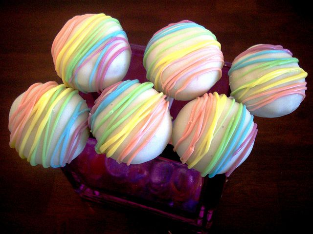 Rainbow Cake Pops, I like this and its a simple idea. The white chocolate looks reeeeeally white though!
