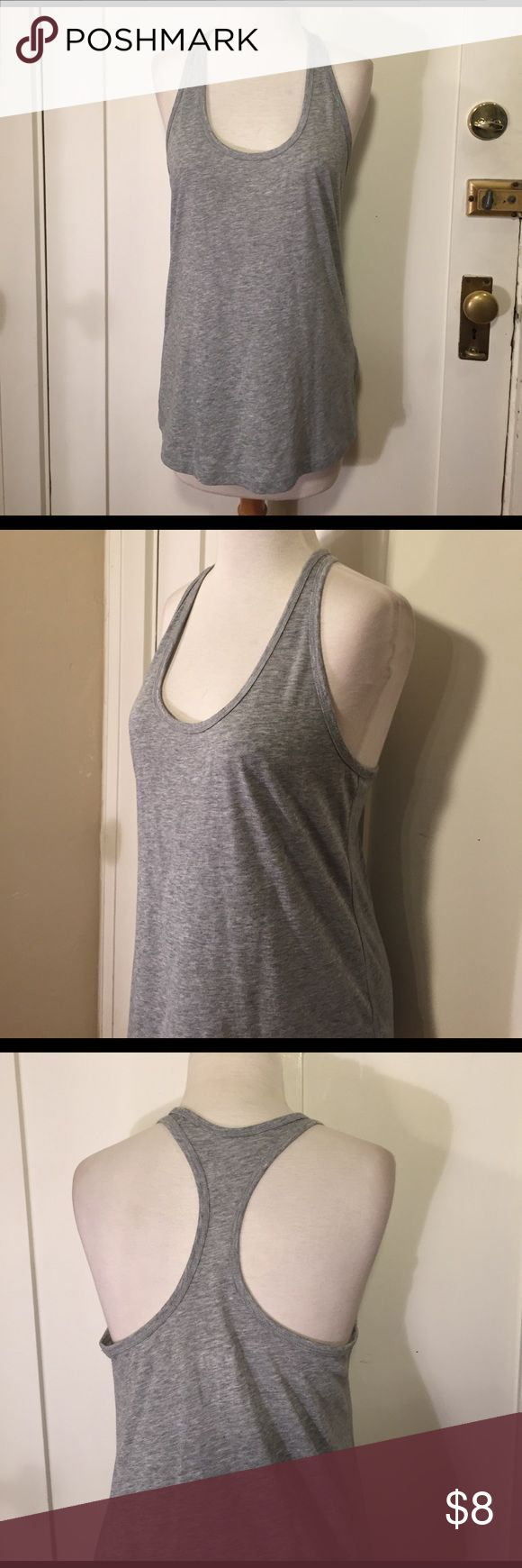 Nike dri-fit loose fit Gray razorback tank This is a gray loose fit razorback tank from Nike, good condition minor wear. See pictures for details. Be sure and check out other items in closet and bundle to receive discounts. Nike Tops Tank Tops