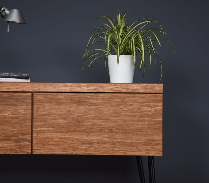 """Dresser / chest of drawers in Mid Century Style Bamboo with two large sturdy drawers that can be filled up to 40 kg each, feet in matt black lacquered iron, entirely hand-built using the finest materials available on the market.    Drawers full extension Blumotion.  measures:                      Length 130cm (51.18 """")                    total height 75,5cm (29.72 """")                          Depth 39cm (15.35 """")  drawer height: 35,5cm (13.97 """")"""