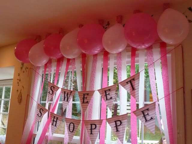 "Sweet Shoppe - Streamer ""curtain"" - Cute idea for a girl's birthday party: Instead of a ""white party,"" a ""Pink Party!""  Ideas and links for where to buy at Simple/Fancy/Fun -  girl's 1st birthday party ideas"