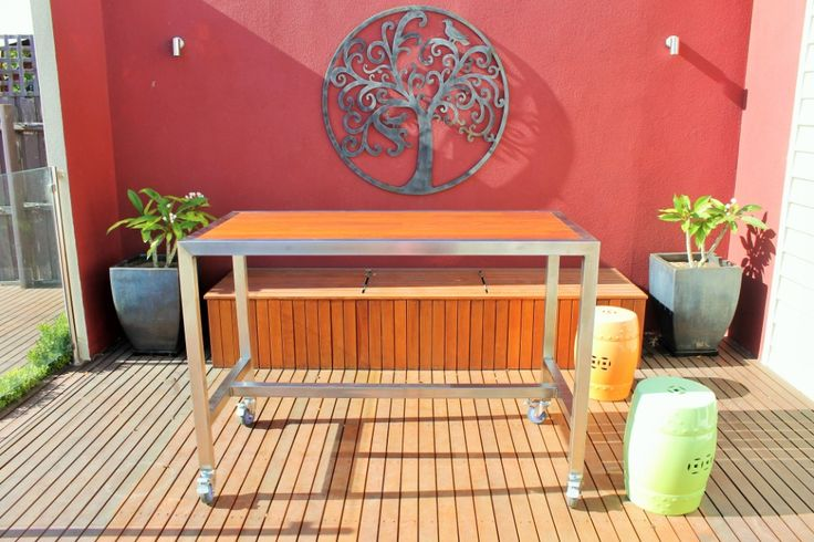 Custom Outdoor Bar Table with Foot Rail, Lockable Castors and Jarrah Timbers. By Outdoor Table Creations