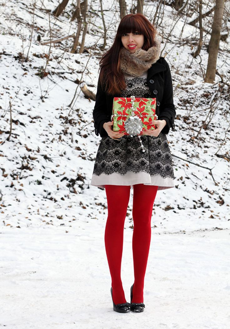 Bright red pantyhose, black and white dress and brown fur scarf