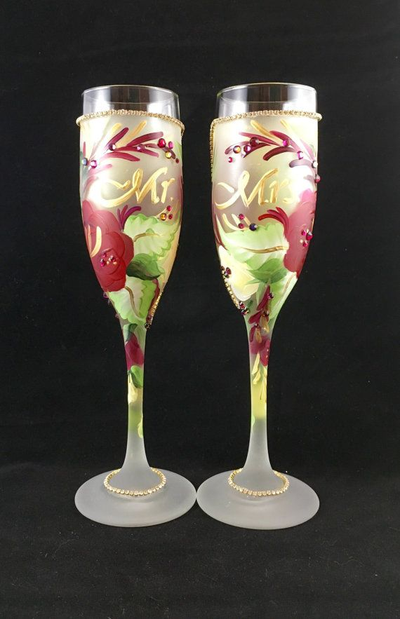 wedding champagne glasses with mr and mrs and roses in maroon and cream accented with swarovski crystals