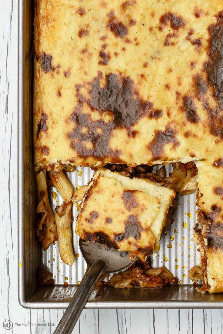 BEST Greek pastitsio recipe! Lightened up, yet delectable and flavor-packed baked pasta with Greek-spiced meat sauce and a golden bechamel topping.