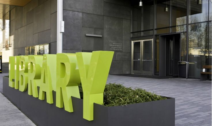 Lime green dimensional letters add a pop of color to the urban streetscape.