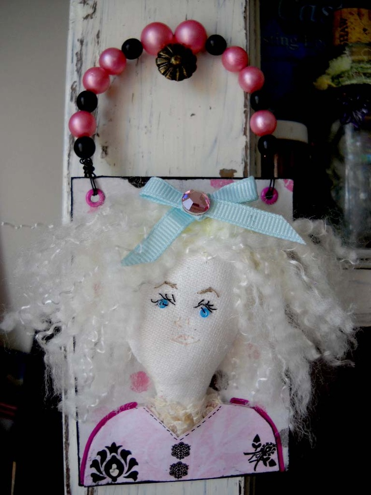 #ATC (artist trading card) (fabric doll head mounted to hanging card) title: That Girl
