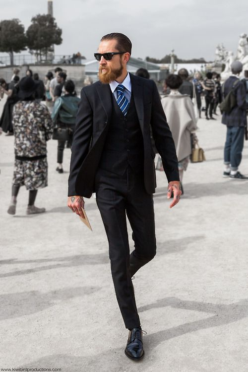 Justin O'Shea, buying director of mytheresa.com, before the Valentino S/S 2014 show in the Jardin des Tuileries in Paris