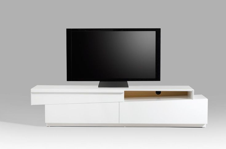 Contemporary slanted white high gloss TV stand with storage drawers. Contemporary high gloss white TV Stand with three drawers and open shelf to bring convenient media storage to your home while infusing the space with a bold contemporary style. This TV stand features three storage drawers perfect f...