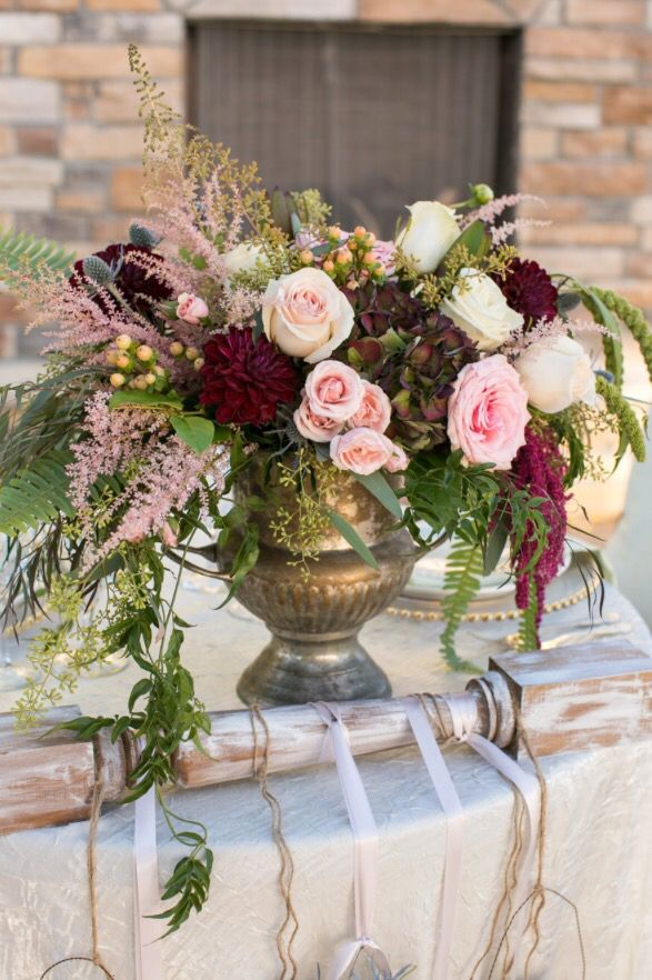 Romantic wedding style, blush pinks, ivory & burgundy wine colors. Vintage silver champagne bucket.