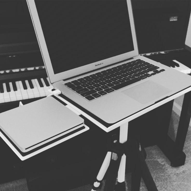 apple macbook air and usb superdrive on a custom white tabelz laptop stand kawai piano