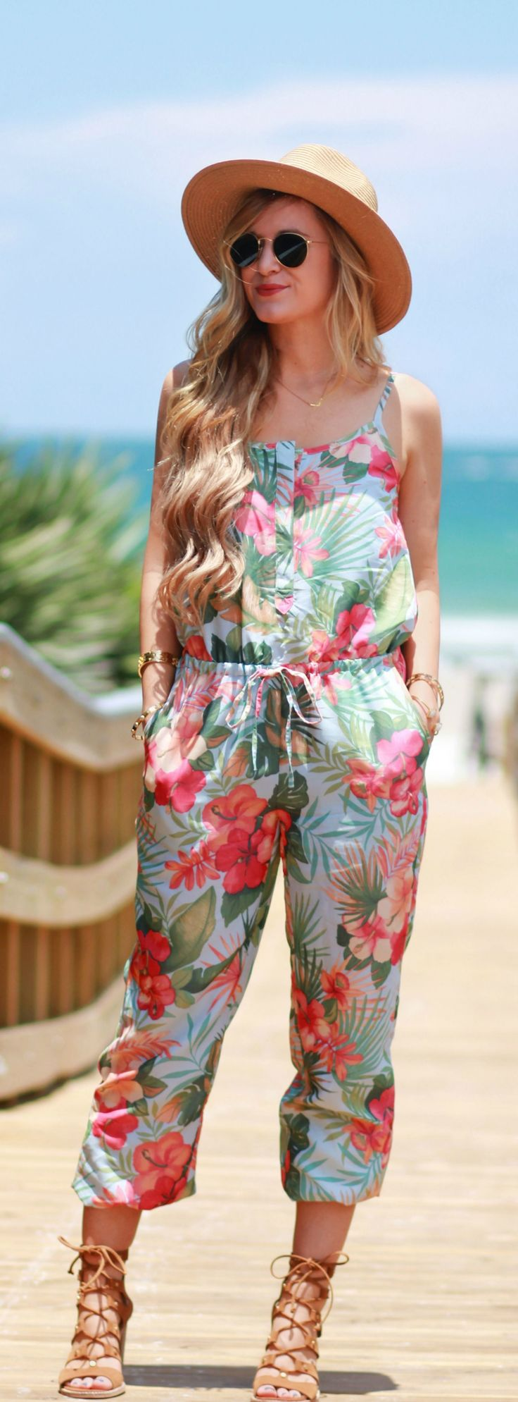 Tommy Bahama tropical print jumpsuit styled with lace up sandals and round Ray Ban sunglasses. Perfect vacation outfit!