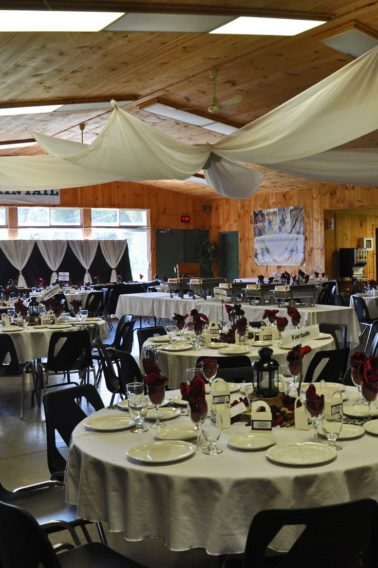 The MacDonald Lodge at Camp Kintail decorated with tableware and linens for a summer camp wedding