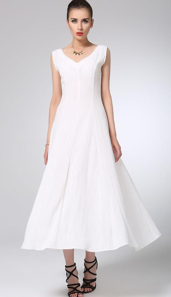 0b1bb0e0c26 Wear everywhere white prom dress from Xiaolizi. The maxi dress made from a  soft white linen fabric in a slim-cut that s cut to a midi length.