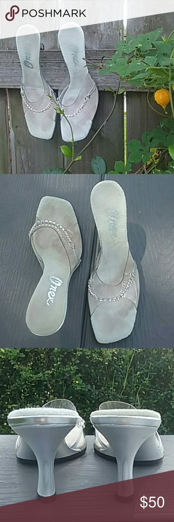 """Finest by Onex Shoes Size 8**Siver/Clear slip ons with Rhinestone strap. Beautiful condition, other than normal wear in toe area. Heel size 2 1/2-3"""". Onex Shoes"""