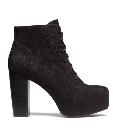 Ankle boots with laces at front and rubber soles. Concealed front platform height 1 1/2 in., heel height 4 1/4 in.