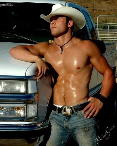 Hmmm....somethin' 'bout a truck...and a hat...and oh my goodness..... DAAAAMMMNNN