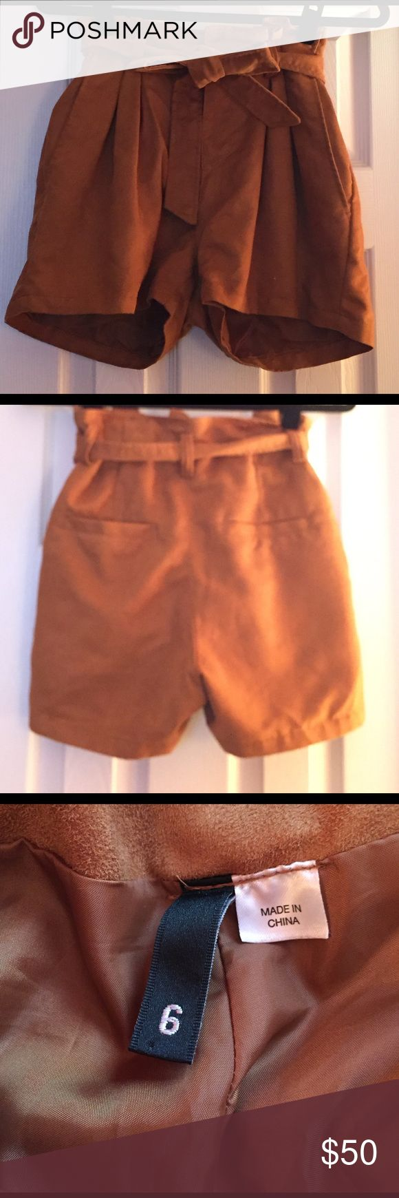 Camel Shorts This is a pair of camel colored shorts. They are super cute and can be worn with a cute pair of tights and riding boots in the fall. Shorts come to about mid thigh and makes your rear appear very flattering. I loved the way these shorts hugged my curves. Shorts