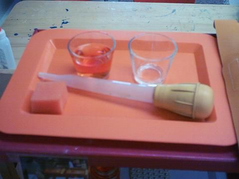 Extension of Pincer Grip Activities  Here the child uses a large syringe to transfer liquid between containers.  This again requires control over the pincer grip in order to be able to collect the liquid into the syringe and then place it in the other bowl
