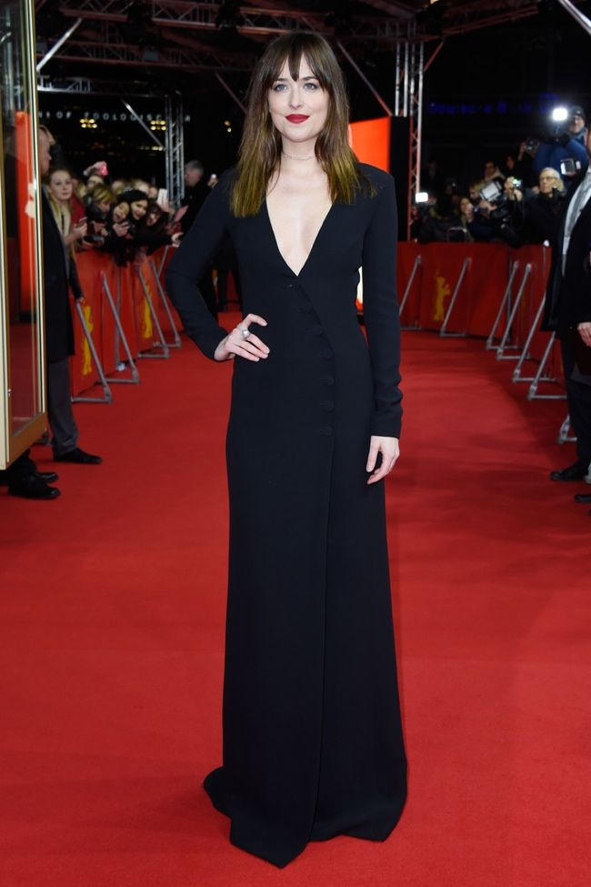 """Following up her sultry behind the scenes images from """"Fifty Shades of Grey"""" were released, actress Dakota Johnson attended the film's premiere at the 65th Berlin International Film Festival held on February 11th. Dakota opted to wear a long-sleeve black silk and wool cadi dress from Dior at the event. The brunette paired the look with a ..."""