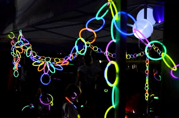 Use glow sticks as the perfect decor for a glow in the dark party.  Better yet, get the kids involved to help!