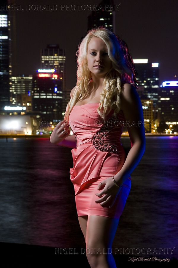 Amy poses in a dress at night.  Women's fashion