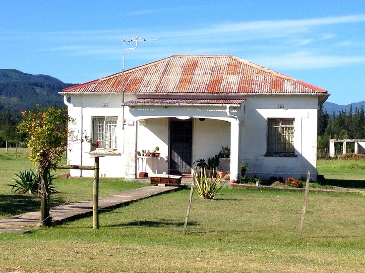 Home in Karatara, South Africa; there are about 50 similar homes here which were once laborers' houses on a large farm. It's a ghost town w/about 200 residents. People sit on their front porches and watch the world go by in this super-quiet village. Photo by Heather Bisson