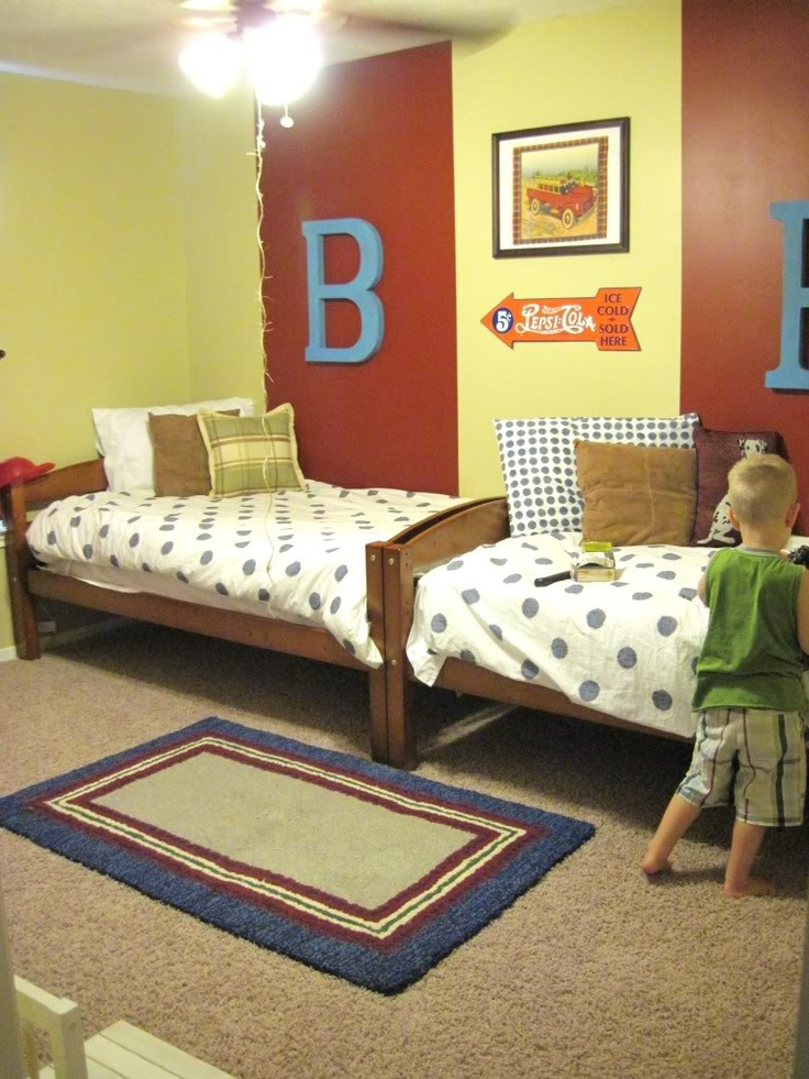 And Then There Was Home: Shared Bedroom for boys ... I like the idea of the beds joined at the footboards.