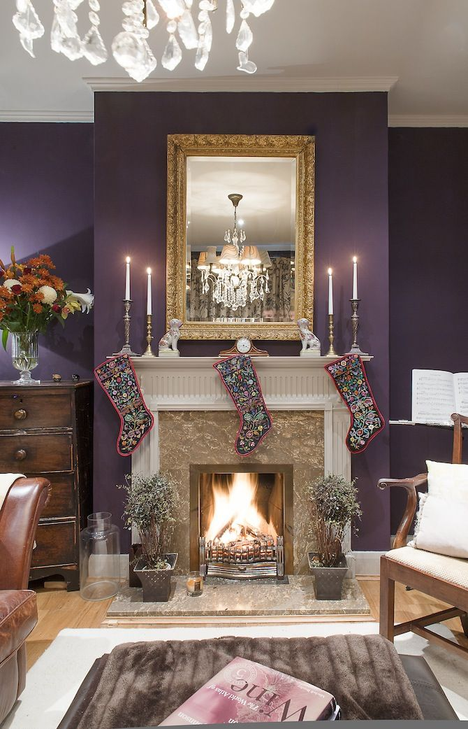 A cozy Christmas living room. (The purple walls are nice)