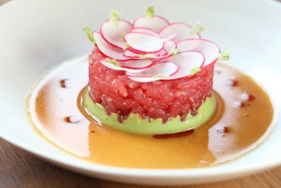 ... Tuna tartare with radishes, avocado, and soy-ginger sauce. Photo